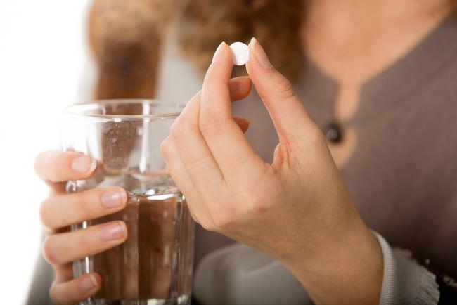 Прием таблеток при гипертензии